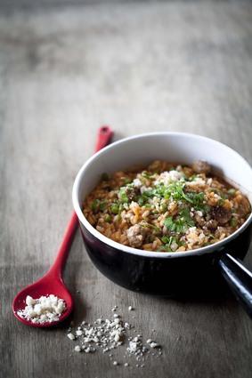 Recette de risotto au tomacouli®, saucisse et petits pois