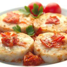 Filets de merlan aux tomates et oignons