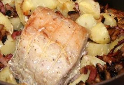 Recette de rôti de porc aux champignons et petits lardons