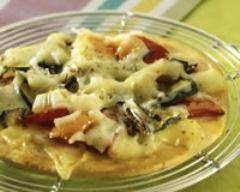 Recette pizzettes aux légumes d'été et à l'emmental