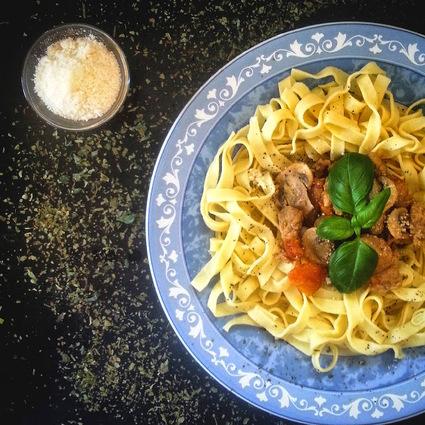 Recette de noix de veau sauce tomatée et champignons