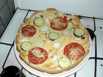 Recette de quiche tomates, courgettes, lardons et chèvre