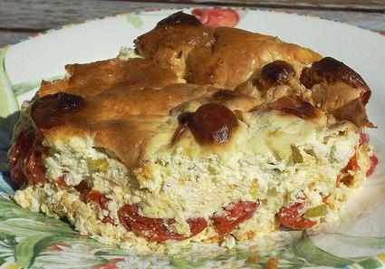 Recette de clafoutis aux tomates cerises, crème fraîche et basilic